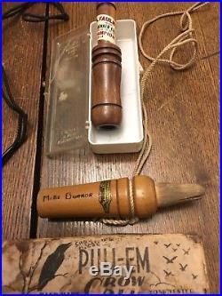 Lot of mostly vintage antique game calls duck, crows, goose, buck, doe, etc