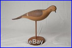 R Madison Mitchell Dove decoy on stand, signed, dated 1981